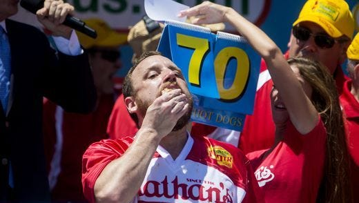 Joey Chestnut wins the Nathan's Famous eating contest in 2016 by demolishing 70 hot dogs.