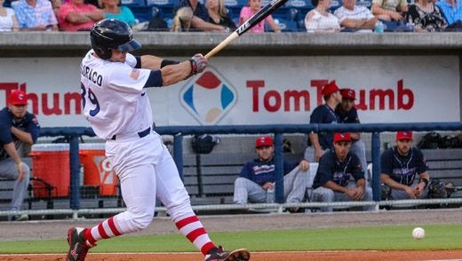 Pensacola's Devin Mesoraco (39), on rehab assignment from the Cincinnati Reds, chops the ball down the line to third base against the Jacksonville Jumbo Shrimp at Blue Wahoos Stadium on Thursday, April 20, 2017.
