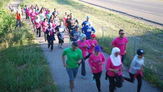 Area Muslims make their way along the I-275 Metro Trail during last year's Fasting 5K for charity.