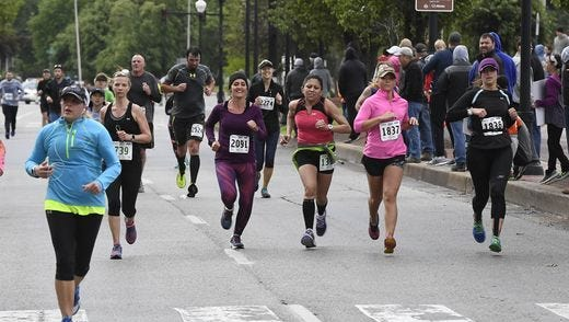 Runners near the finish line on Riverside Drive in the 2017 River Run Saturday, May 6, 2017.