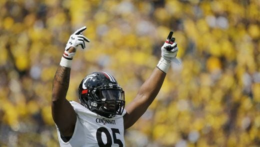 University of Cincinnati defensive end Bryan Wright celebrates a third-down stop during Saturday's 36-14 loss at Michigan. The Bearcats next face rival Miami University.