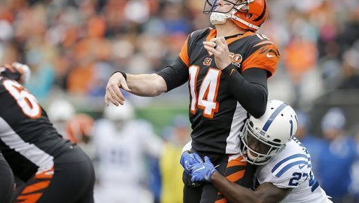 Bengals QB Andy Dalton is hit as he throws against the Indianapolis Colts on Sunday.