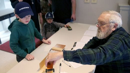 A Pinewood Derby contestant prepares his entry. The annual Pinewood Derby workshop takes place this weekend at the Greater Hansville Community Center.