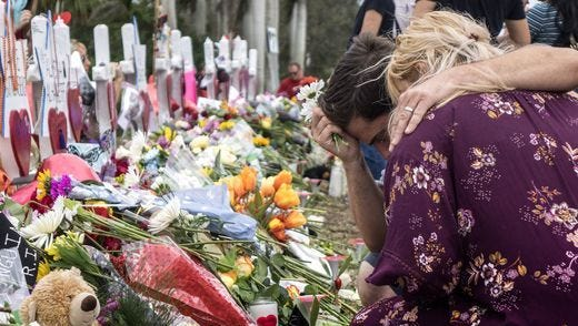 A makeshift memorial emerged at Marjory Stoneman Douglas High School after the recent shooting that claimed 17 students' lives.