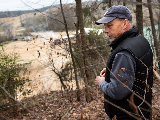 Camden resident Mike Melton looks at the landfill from