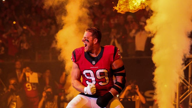 Houston Texans defensive end J.J. Watt (99) walks onto the field before a game against the New England Patriots at NRG Stadium.