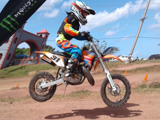 Richard Wenden, 7, a member of the Guam International Raceway Motorcycle and ATV Club (GIRMAC), started riding at age 3 with his  motocross-riding dad Tim Wenden's guidance. At age 4, he began to race competitively as part of the GIRMAC* Club, and now rides a KTM50, sponsored by Rocky Mountain Precast. He races his 50cc (pictured) against boys mostly 3 or 4 years older, riding 65cc bikes. He recently placed second in the 65cc Class of the 2017 Monster Energy Guam MX Championships. Wenden has been selected from hundreds of applicants from all over the world to participate in the KTM Jr. Supercross Challenge (KJSC) to be held May 6 (May 7, Guam time) in Las Vegas, Nevada.