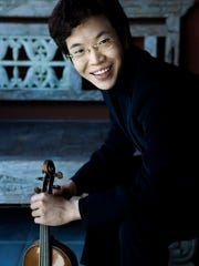 Young violinist Paul Huang visits the Barre Opera House on Sunday.