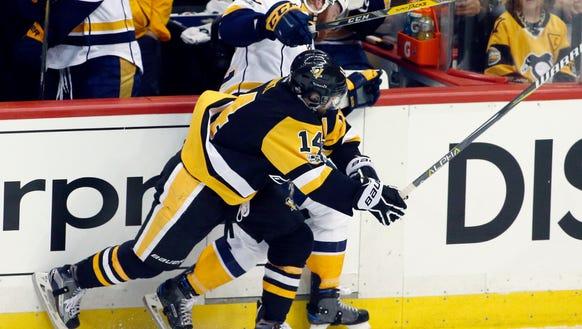 Pittsburgh Penguins' Chris Kunitz (14) checks Nashville