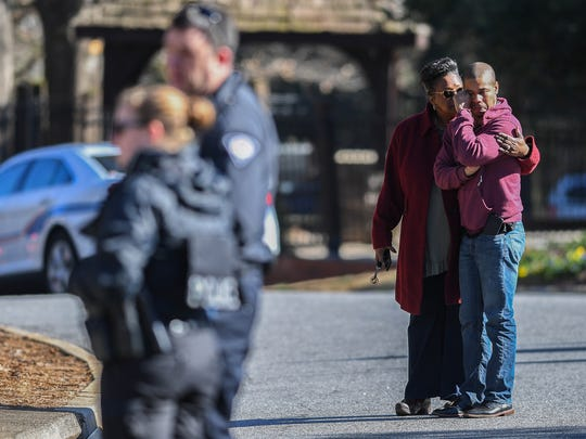 Wilhelmina Hagood consoles her son Dominic Austin Jr. as they watch firefighters work a fire at his apartment at the Plantations at Haywood Apartments off Haywood Road in Greenville on Friday, March 9, 2018. The apartment was Austin's first and his mother came to the apartments to be with him after hearing of the fire.
