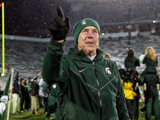 Michigan State coach Mark Dantonio gestures to the