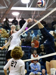 Palmyra's Memphis Martin, left, gets the ball past