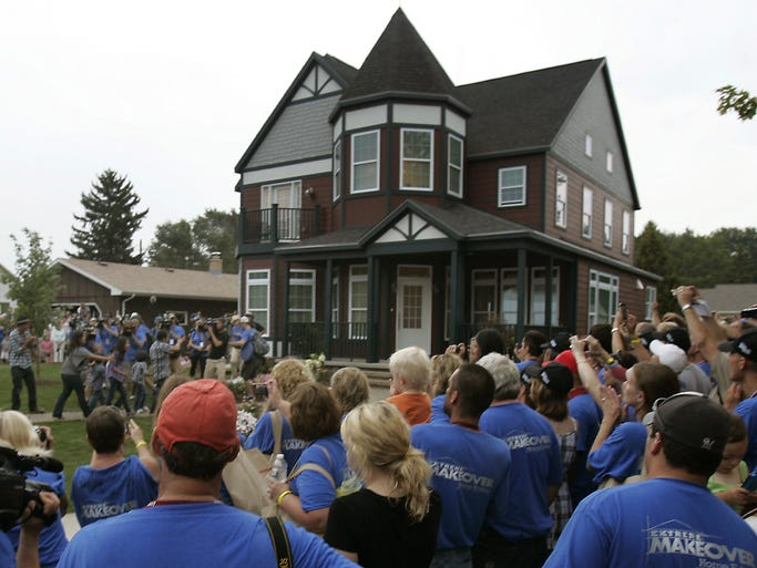Thousands gather to watch as the Arboleda family returns home to their new house on the final day of filming for Extreme Makeover: Home Edition on Friday August 20, 2010 in Neenah, WI. The Post Crescent Photo by Wm. Glasheen
