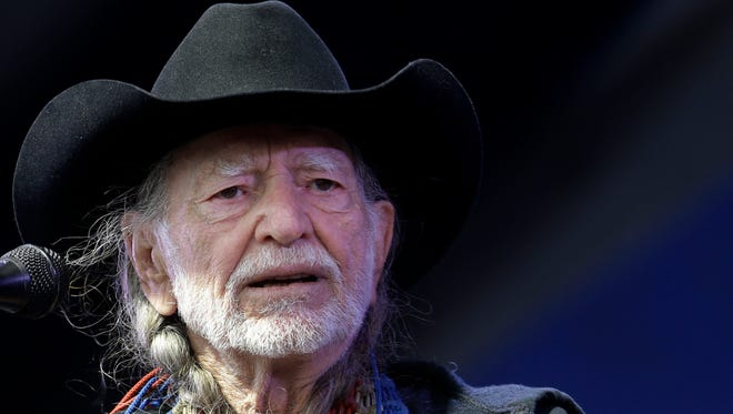 Willie Nelson performing at the New Orleans Jazz and Heritage Festival in New Orleans on May 3, 2013.