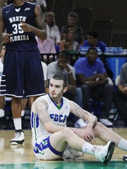 FGCU's Brett Comer reacts to loosing the ball against North Florida on Wednesday at Alico Arena.