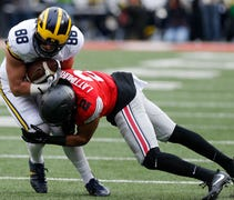 The rivalry game Saturday, Nov. 25, at Michigan St...