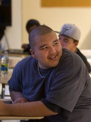 Student Jerry Moreno participates in a science class last week at Charlie Yazzie Brown High School in Bloomfield.