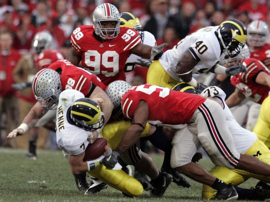 Michigan's Chad Henne is sacked on Saturday, Nov. 18, 2006 in Columbus, Ohio.