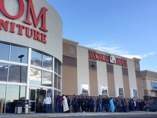 A line forms outside of HOM Furniture in St. Cloud