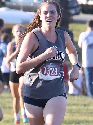 Greenwood's Macie Cash runs toward the finish line, Thursday, Oct. 8, during the Greenwood XC Invitational in Bell Park. Cash finished second in the 5A girls state meet Friday at Hot Springs.