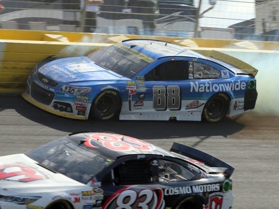 Dale Earnhardt Jr. (88) hits the wall in Turn 2 during