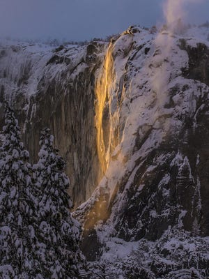 This Sunday, Feb. 17, 2019, photo released by Dakota Snider shows Horsetail Fall in Yosemite National Park, Calif.