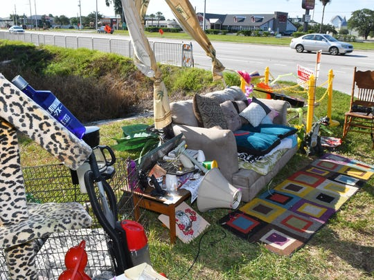 A couch that had been placed along Palm Bay Road weeks ago has been getting plenty of humorous attention, people posing for photos,  and internet shares, as residents keep adding more household items to the scene. On Sunday night, volunteers moved the ever growing display to a grassy area near the entrance to Walmart.