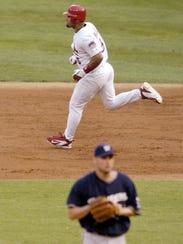 The Cardinals' Albert Pujols runs the bases after hitting