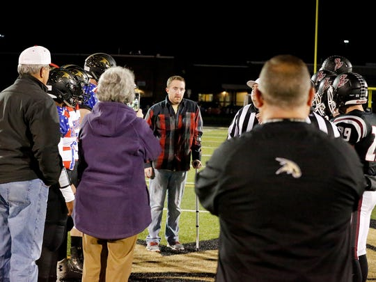 Using a crutch to steady himself, Will Condon gathers with Corning-Painted Post and Elmira football players at the beginning of the Oct. 14 contest at Corning Memorial Stadium. Corning's football program raised more than $5,000 to help with the costs of Condon's medical care.