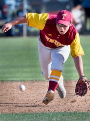 Tulare Union's Peter Gonzalez picks up a hit ball against