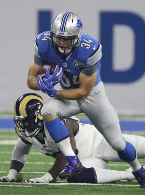 Lions running back Zach Zenner carries the football during the first half Sunday, Oct. 16, 2016 at Ford Field in Detroit.