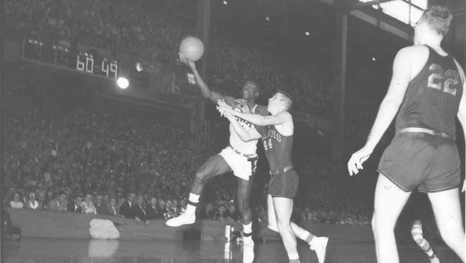 Freeport grad Carl Cain scores on a layup for Iowa. Cain averaged 12.9, 13.6 and 15.8 points in his three seasons for the Hawkeyes from 1953-56 and was named honorable mention on Iowa's All-Century team.