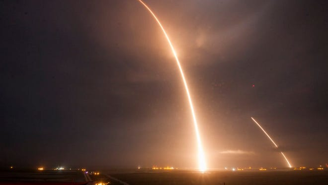 A Falcon 9 rocket launches from and lands at Cape Canaveral Air Force Station in this composite photo on Monday, Dec. 21, 2015.