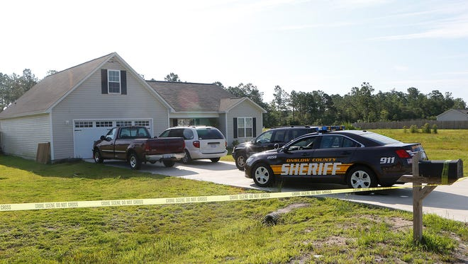 Onslow County Sheriff's vehicle at residence on Cherry Blossom Ln., Richlands, Monday morning July 14, 2014.