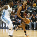 Charlotte Bobcats guard Ramon Sessions (7) drives to the basket against Denver Nuggets guard Nate Robinson (10) during the first half at Pepsi Center.