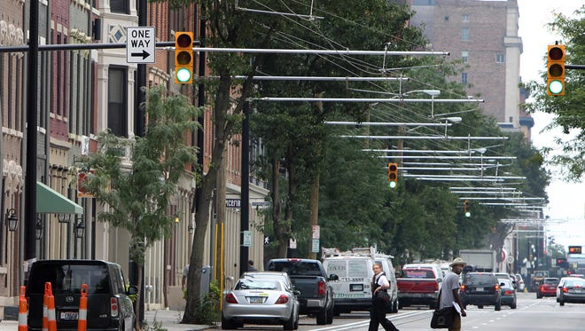 View of overhead streetcar electrical system on Race Street near 15th Street looking south.