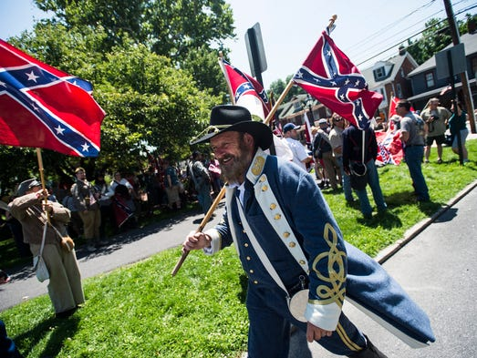 Marchers protest the removal of the Confederate flag