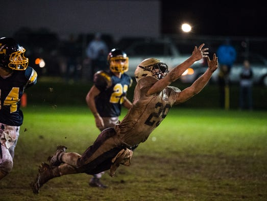 Delone Catholic's Ryan Hart attempts to leap for a