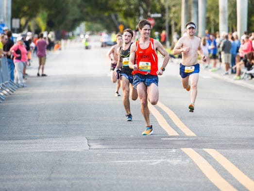 Runners approach the finish line during the Naples