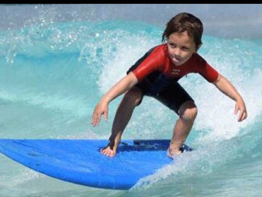A youth competes in the Guam Hui Nalu Ocean Club at