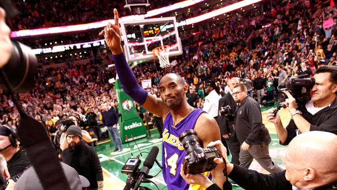 Kobe Bryant waves goodbye to the Boston crowd one final time.