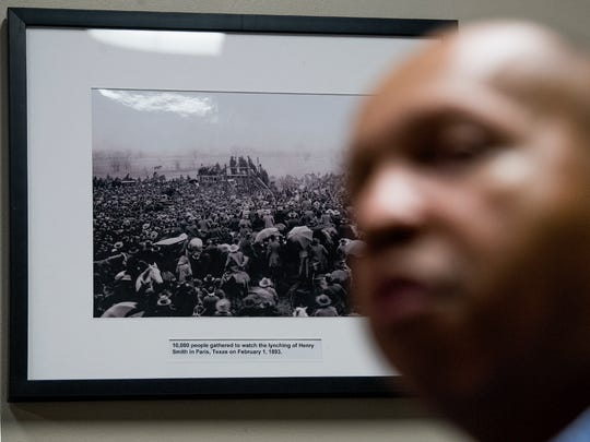 A photo of a lynching in Paris, Texas, hangs on the wall as Bryan Stevenson, Executive Director of the Equal Justice Initiative, talks at the EJI offices in Montgomery, Ala. on Friday April 13, 2018.