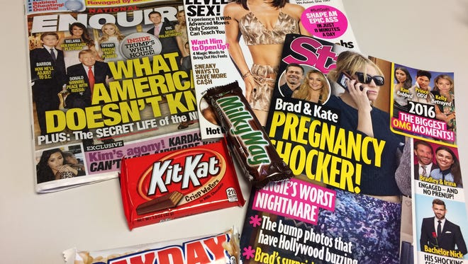 Sugary treats and racy headlines at kid eye-level purchased at the Meijer Okemos store on Tuesday, Dec. 27, 2016. A Bath Township mom wants them replaced with healthy options.