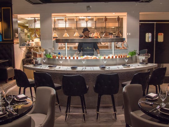 The initimate scratch bar anchors a dining room in The
