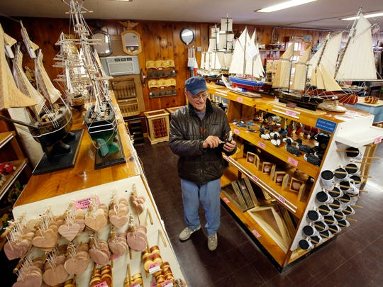 Ken Carreras of Stockton Springs, Maine, examines a wooden lock at the Maine Prison Store, Friday, Nov. 28, 2014, in Thomaston, Maine.