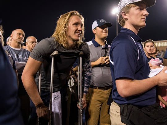 Isaiah Dunham wears crutches at the end of Reitz's 28-21 come-from-behind regular-season win over Central Sept. 8. Dunham, who was injured with less than two minutes left, hopes to return for Friday's rematch.