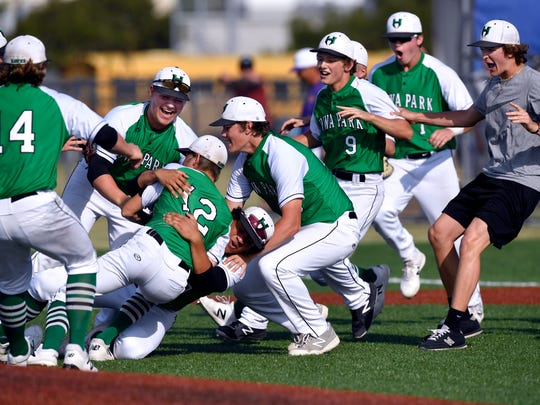 Iowa Park players celebrates their win over two-time defending state champion Wylie on Saturday. Down a game, the Hawks came back Saturday to sweep the Bulldogs to capture the Region I-4A series.