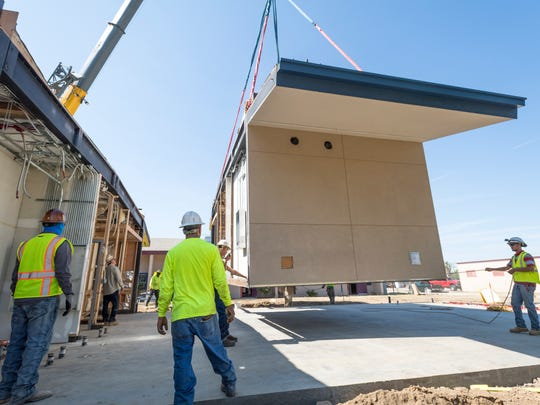 A crane was used Tuesday, July 17, 2018 to place modular segments of the Goshen School's new library, teacher work room and office.