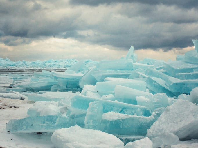 Blue ice is seen on the shores of the Straits of Mackinac