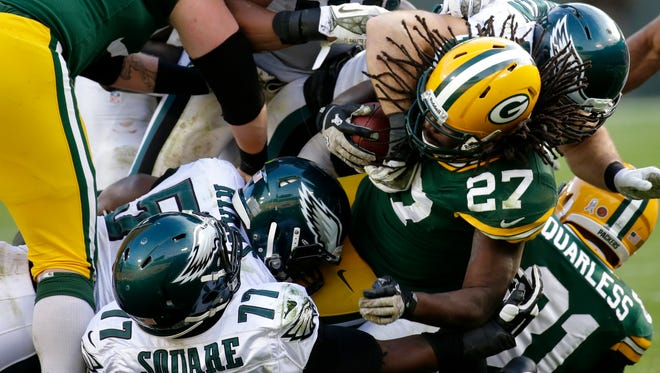 Packers running back Eddie Lacy is brought down be the Philadelphia defense in the third quarter of their 2013 game.
